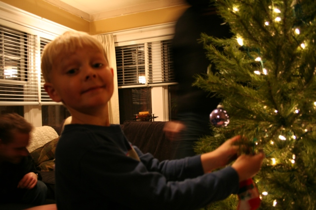 Micah, showing great satisfaction with his placement of an ornament!