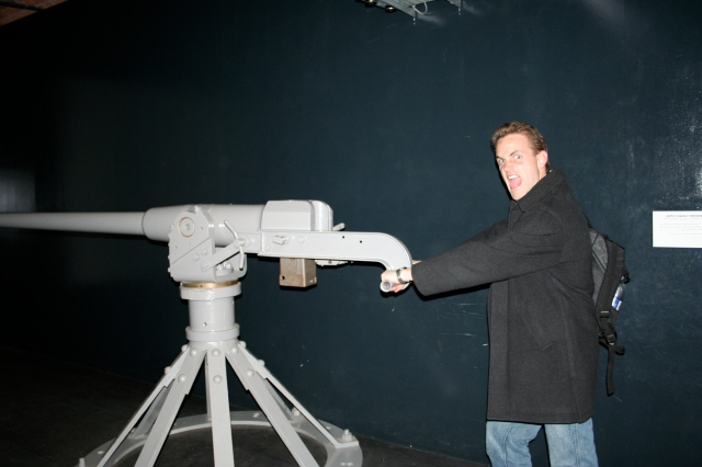Scotty manning a gun from a WWI era ship.