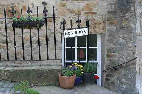 I love the house numbers and flower boxes.
