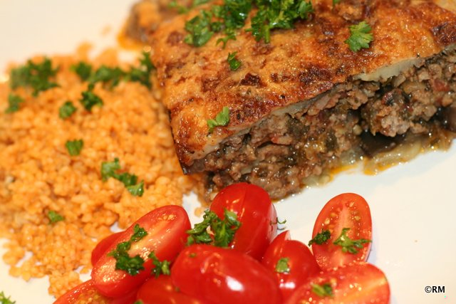 Moussaka with bulgar wheat and a tomato salad.