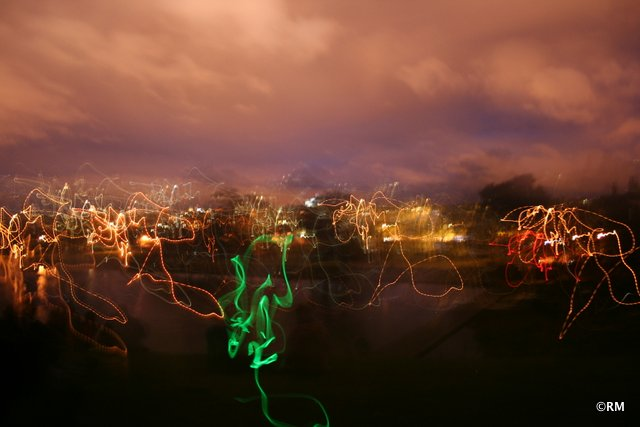 The squiggly lights were light sticks and flashlights from other people gather at the park.