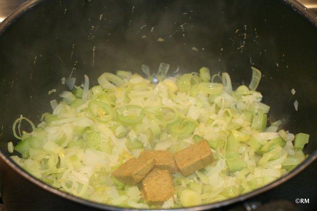 Bullion cubes added to the softened veggies.