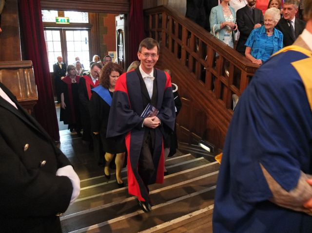 One of Scotty's supervisors enters during the faculty procession.